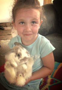 Cute kid and rabbit
